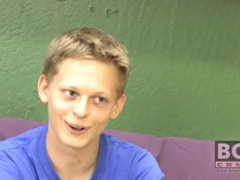 Blond young sexy twink on a purple sofa