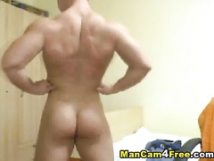 Young handsome gay sexily undresses and poses nude