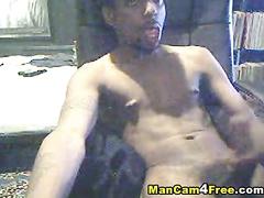 Scrawny black dude is jerking off on gay porn