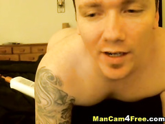 Sexy gay guy with hot tattoos is pleasuring exciting dick masturbation