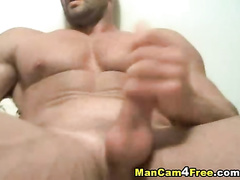 Gay bodybuilder is hotly jerking off on gay pornvideo