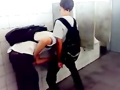 Two sexy schoolboys are having nice oral sex in the toilet