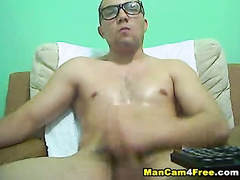 Twink hotly jerks off and cums on his belly