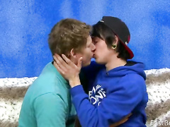 Young guys exchange kissing and cock blowing