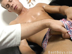Stroking the cock of a sporty young dude